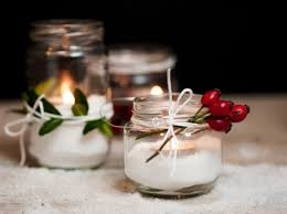 composizione di candele decorazioni di natale con barattoli di vetro candele natalizie