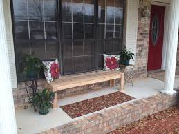 exterior blue painted porch bench with curved arm rest and back