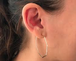 auricular acupuncture what s the deal with those tiny gold studs