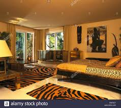 tiger print rugs in spanish bedroom with leopard print bedlinen