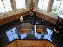 marble countertops corner kitchen sink base cabinet lighting