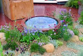 Water Rock Garden Tiny Water Feature In Garden Of Flowers Plant Flower Stock