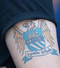 man city consider paying for fans to remove tattoos of club badge