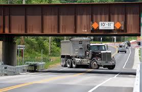 walmart truck stuck under crane street overpass the daily gazette
