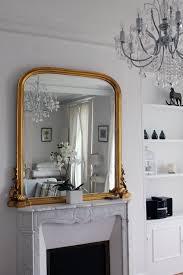 parisian home decor inspiration marble fireplace gold mirror