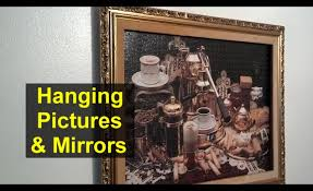 hanging mirrors and pictures use very small nails home