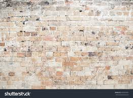 red weathered exposed brick wall background stock photo 583599463