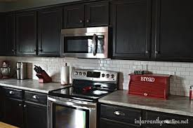 shining black kitchen cupboards and subway tiles best 25 white