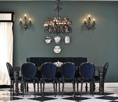 black diningtable with blue velvet dining chairs contemporary