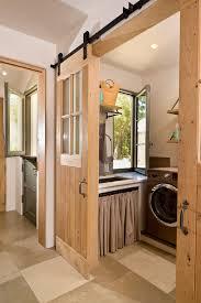barndoor ideas laundry room mediterranean with wall shelves stone