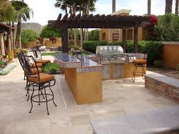 elegance outdoor kitchen design with blue tile countertop