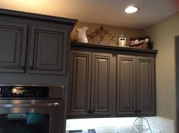 Decorating The Top Of Kitchen Cabinets Help Is Above Kitchen Cabinet Decorating Outdated