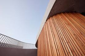 curved wood wall farewell chapel by ofis arhitekti dezeen