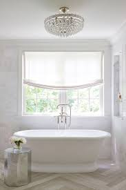 designs winsome chandelier over bathtub images 80 a metal orb