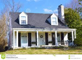 white cape cod style home with black shutters google search