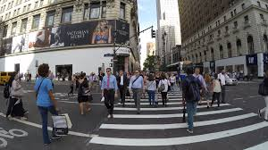 people walking on herald square at 34th st and broadway stock
