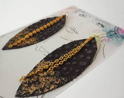 dipped in gold feather earrings leather feather jewelry dipped in gold