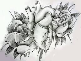 black and grey real heart with two roses tattoo design by katie matie