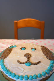 homemade birthday cake in a shape of a dog face stock photo