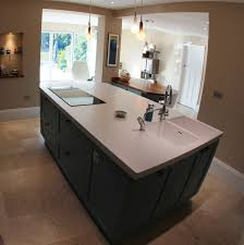 this large island is the primary work surface in this kitchen