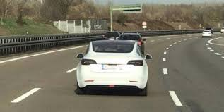 a tesla model 3 spotted in germany reportedly with new
