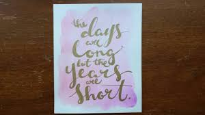 art of words boutique the days are long but the years are short hand lettered watercolor painting canvas quote art home decor wall hanging inspirational sign