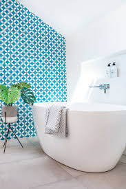 Blue And White Bathroom by This White And Wood Bathroom Has A Bright Blue Accent Wall To