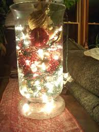 ornaments and lights in a vase