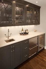 Wet Bar Sink And Cabinets Gray Butler U0027s Pantry Boasts Glass Front Upper Cabinets With Gray