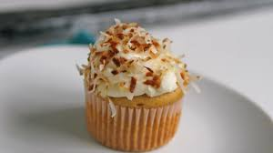 rum cupcakes with coconut frosting recipe bettycrocker