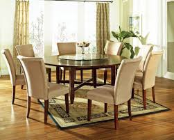 dining room round table canada inch pad seats how many with leaf