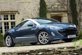 peugeot coupe rcz interior peugeot rcz 2010 car review honest john