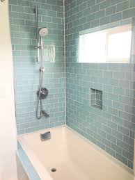 guest bathroom using blue ceramic subway tiles wall shower bath