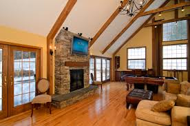 rustic style living room designs with vaulted ceilings and stone