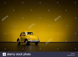 yellow volkswagen beetle royalty free izmir turkey february 16 2015 toy volkswagen beetle on yellow