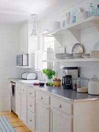 kitchen style classic white cabinets open shelving beach kitchen classic white cabinets open shelving beach kitchen white dinner wares stainless steel countertop glass canister