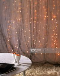 Curtain Fairy Lights by Living Room Interior With Fairy Lights Stock Photo Getty Images