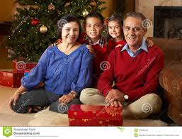 grandparents with grandchildren by christmas tree royalty free