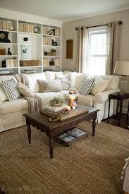 cottage livingroom cozy cottage living room wall to wall bookshelves pottery barn