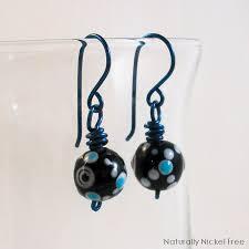 niobium earrings blue dot glass bead earrings with anodized blue niobium wire