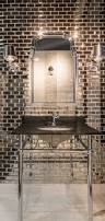 cherry kitchen cabinets with white granite dark wood gray walls kitchen backsplash tile antique mirror bevel amalfi glass wall infused metallic and reflective elements in this bathroom tile the antique mirror