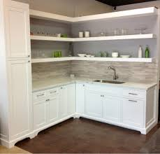minimalist kitchen with carrara marble laminate countertops white