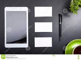 top view office desk mockup stock photos images pictures business card blank notepad coffee cup and pen flower at office desk table