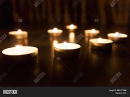light up christmas candles candles glow dark background image photo bigstock