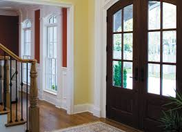 stately stone home wood entry doors pella photo gallery