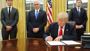 Oval Office Gold Curtains Trump In Oval Office Signs First Order On Obamacare Brainerd