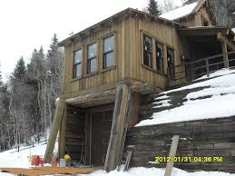 home site challenges can lead to inspired log home design bunkhouse over garage