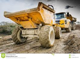 muddy truck dumper truck and lorry in mud on construction site stock photo