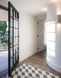 black wooden door frame lamp on the wall wooden floor unique