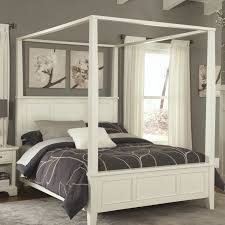 wooden canopy bed with high head board also